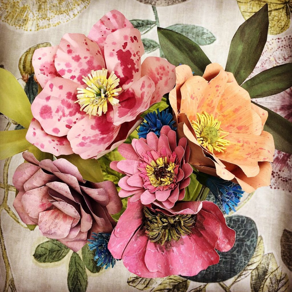 Demonstration of paper flower making by Corinne Young for workshop in Cumbria, UK.